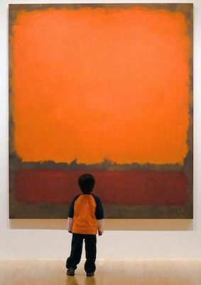 Kid looking at a painting by Mark Rothko